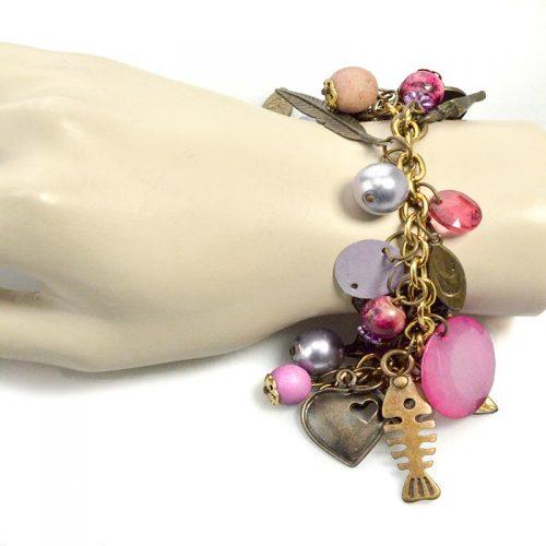 Pink charm bracelet on wrist