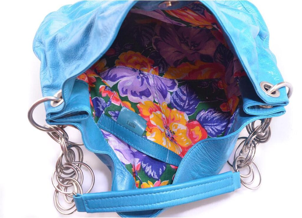 blue handbag with chains