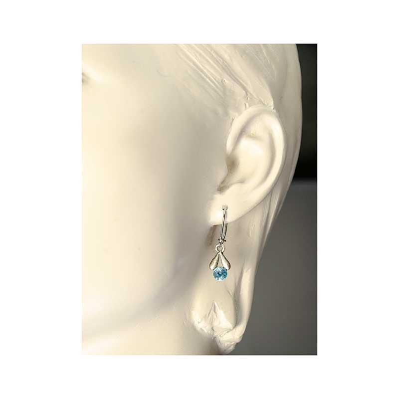 Small leavy Swrovski earrings in ear